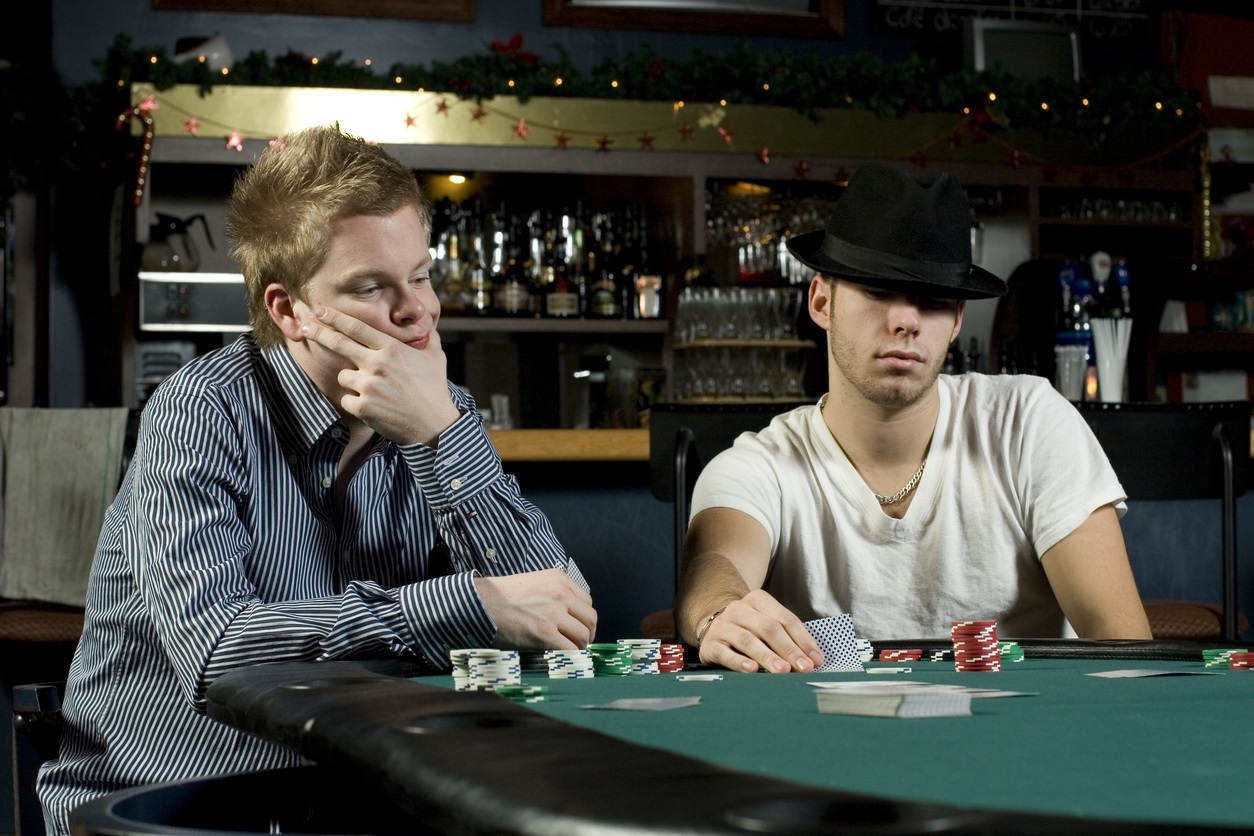 Two card players with poker faces